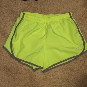 Lime yellow and gray Nike running shorts